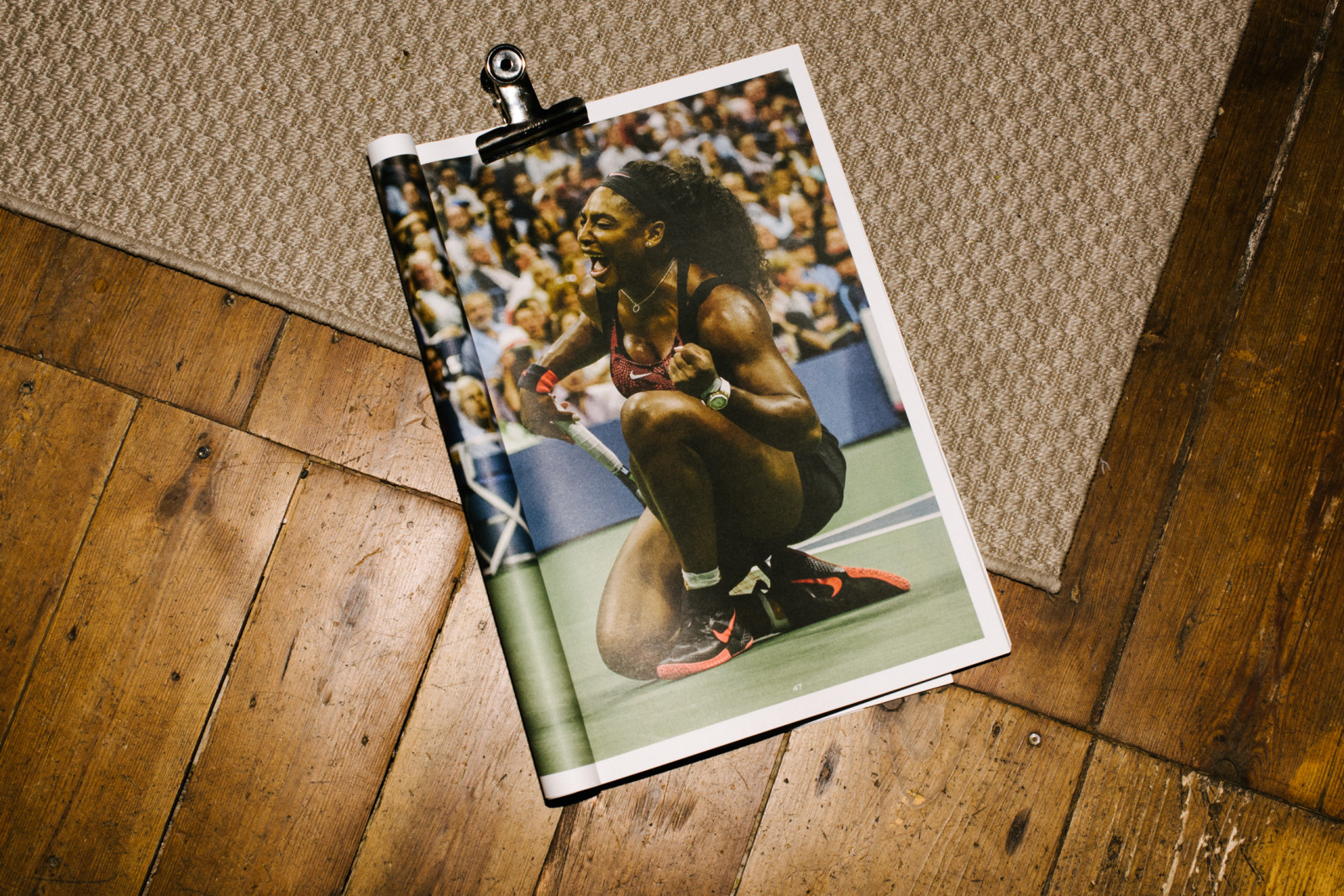Serena Williams celebrating a victory over her sister, Venus. Taken from a photographic essay on the two tennis superstars.