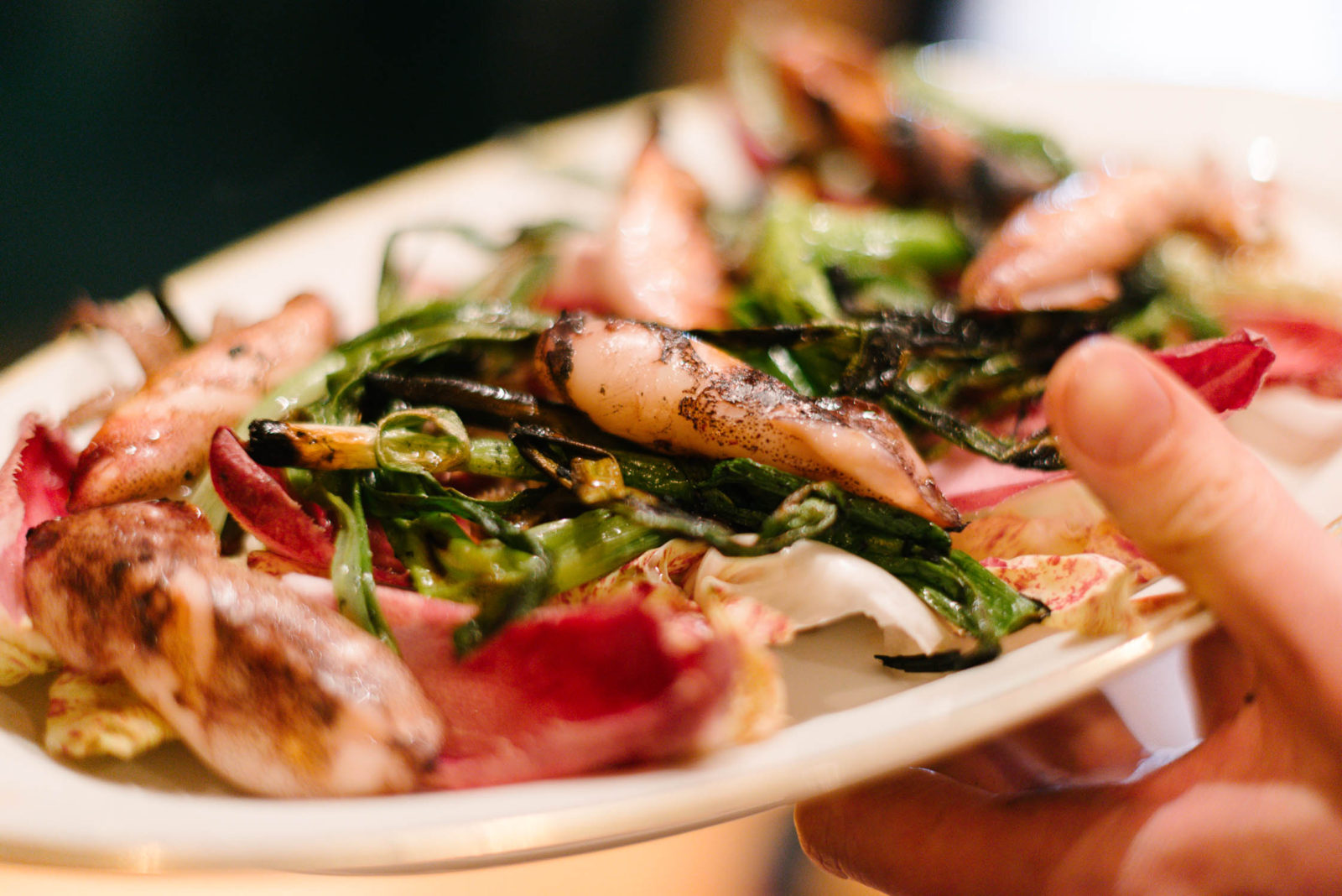 Grilled squid, bitter leaves and pickled plum