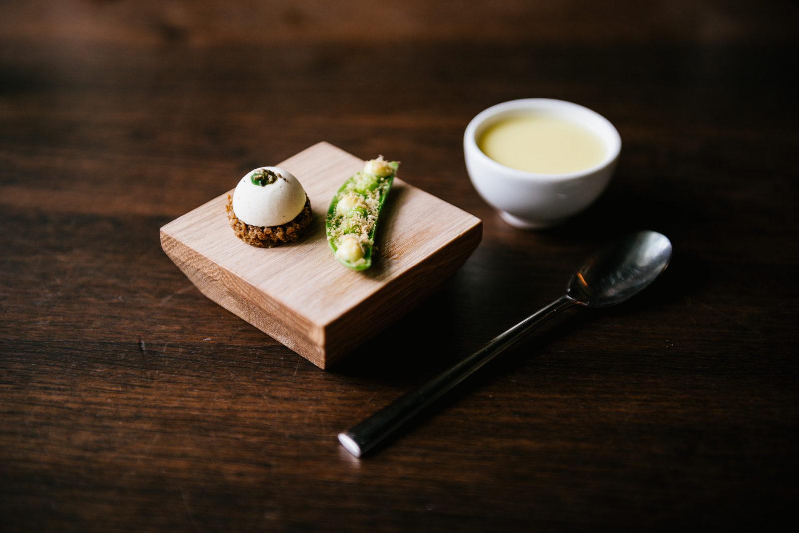 3 snacks, L-R: Rye bread, mackerel butter, lovage; pea, dried wild salmon roe; smoked cod custard
