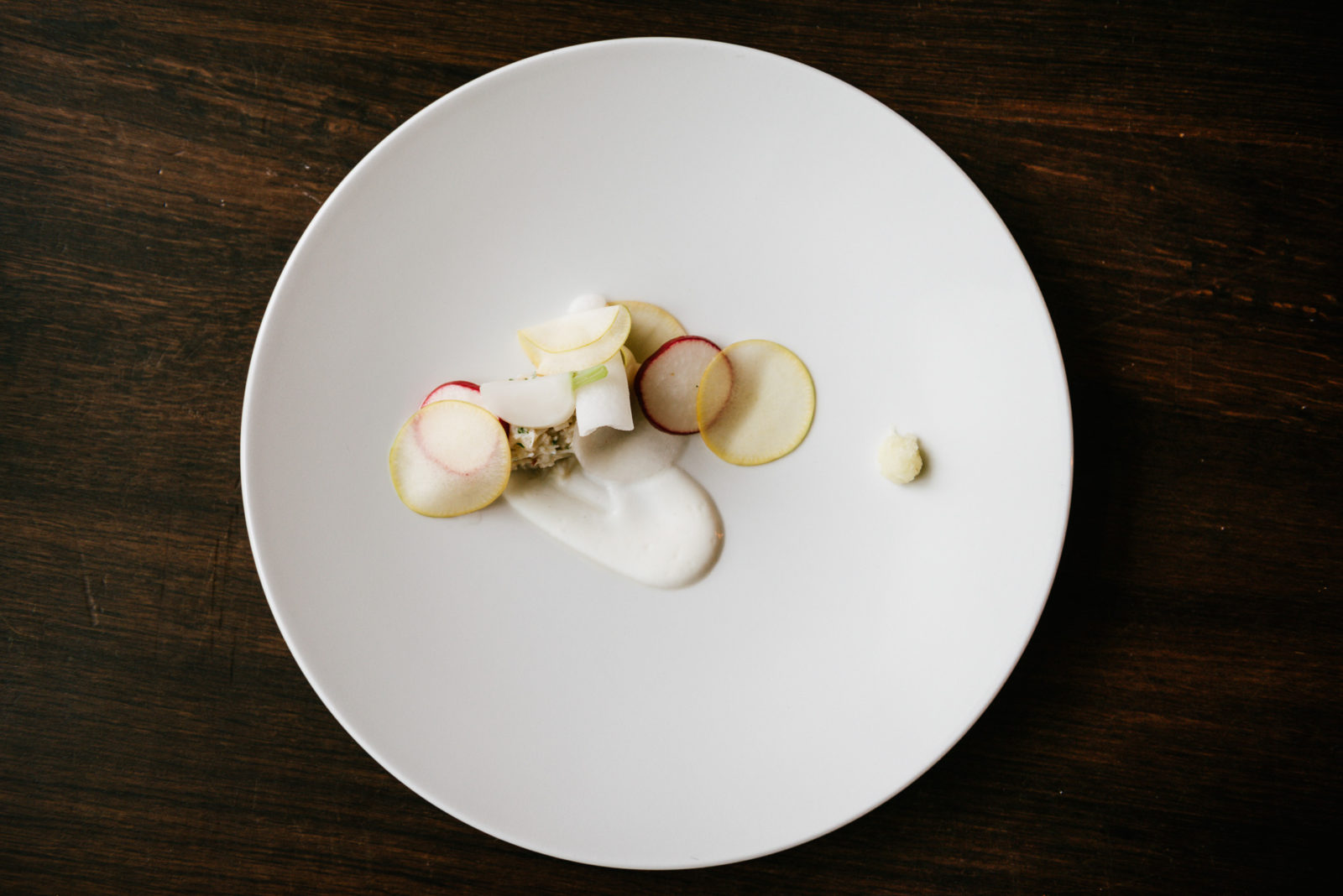 Turnip with smoked yoghurt, radish and crab salad