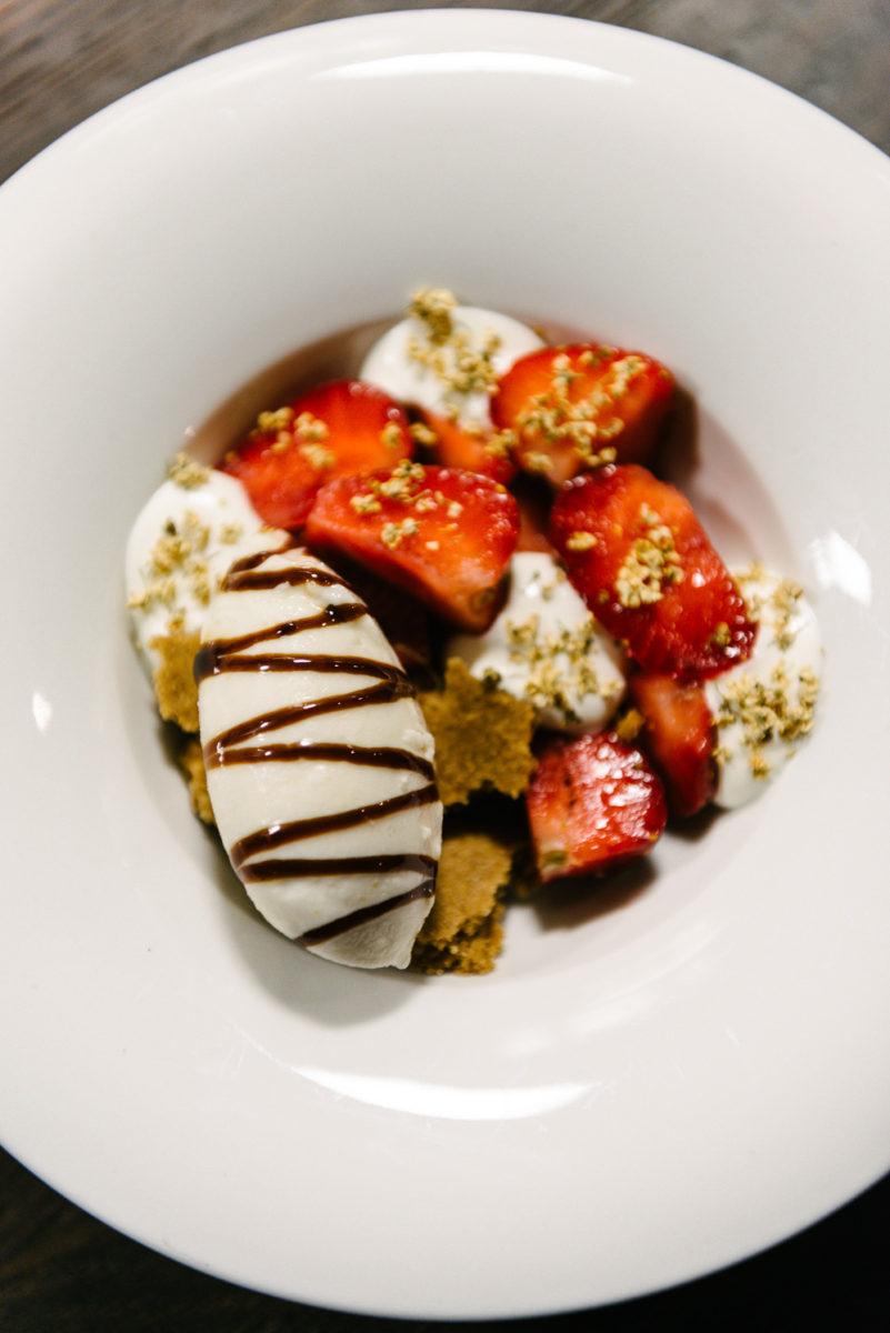 Strawberries, whipped goat's milk, molasses and elderflower ice cream