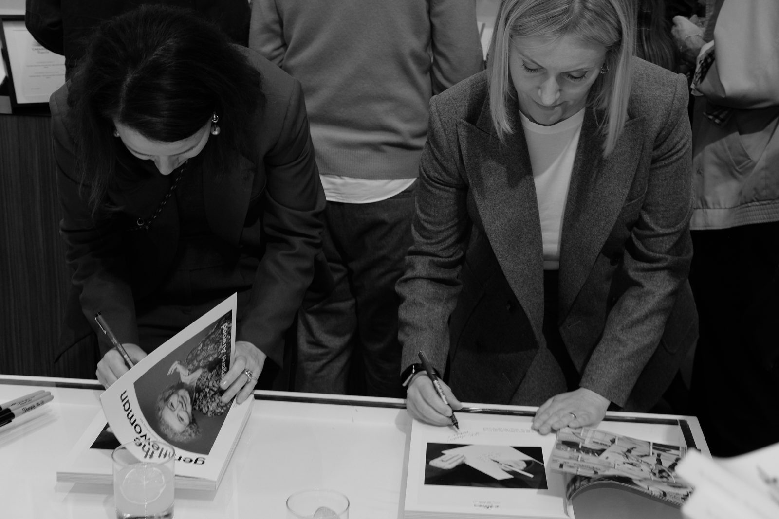 (EN) Penny Martin and creative director Veronica Ditting signing copies of the issues.