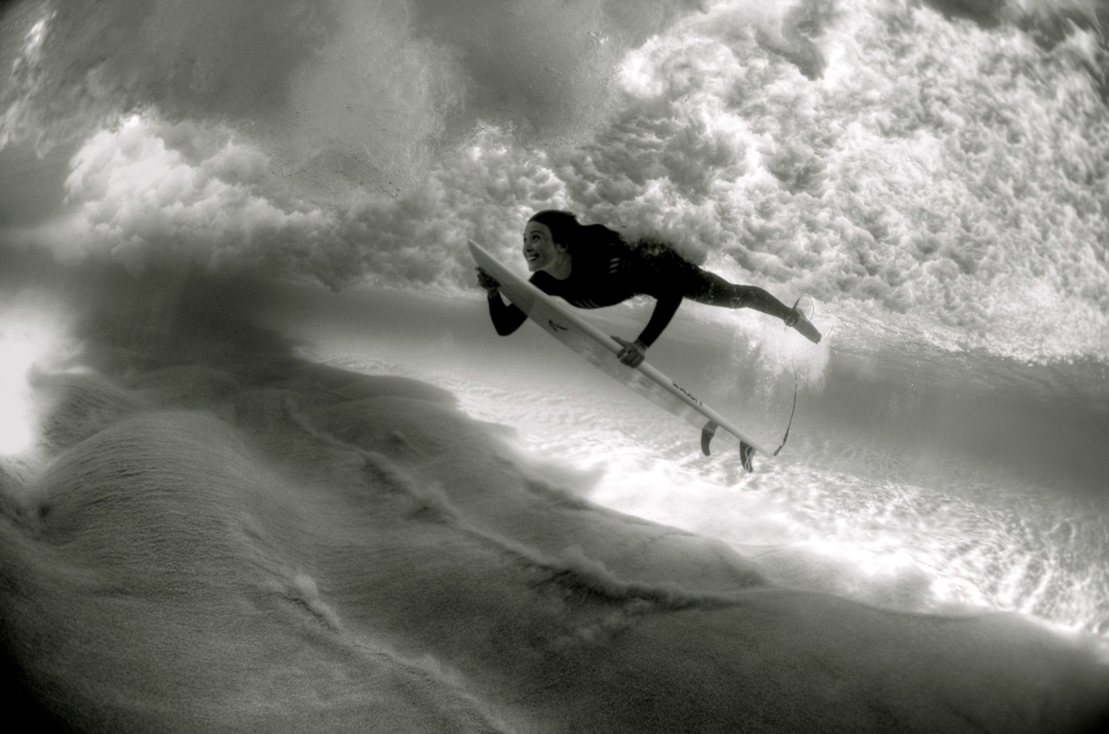 """In surf photography, the sea is my focus. How does the surfer  interact with the sea? How does they clash with it?"""