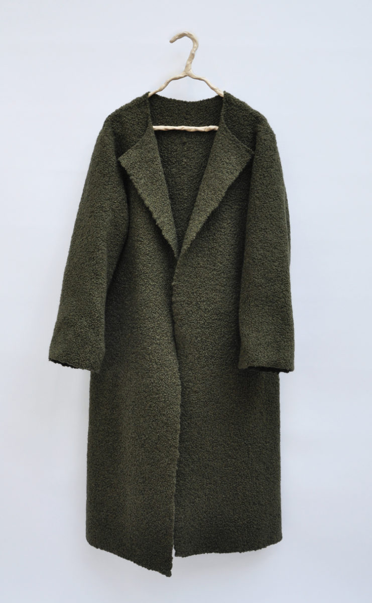 Silk and wool, felted and brushed for hours after the cloth was woven. All seams stitched tapestry-style by hand for an entirely seamless coat.